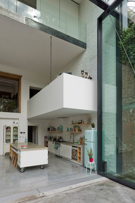 Polished concrete forms the floor of the extension and continues out into the garden terrace, providing a sense of continuity between interior and exterior spaces (with a kitty <3 )