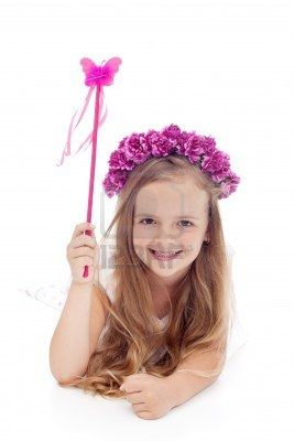 Little fairy with flower wreath and magic wand smiling Stock Photo - 14304557