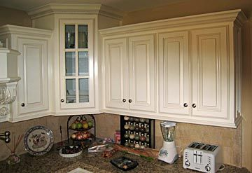 kitchen cabinets - molding at bottom of cabinets ...