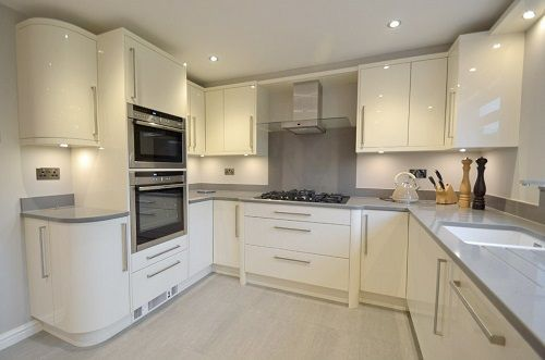 "cream gloss curved corner units | Our new kitchen has transformed our home"" read about our modern ..."