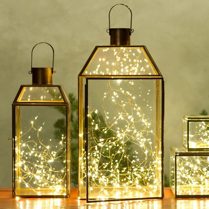 Instant Holiday Decor: Holiday Lanterns with Stargazer Lights from Terrain. Drop these tiny wire lights into a lantern or jar and you're done!