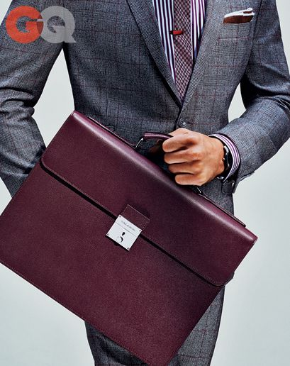 Briefcase, $1,745, by Dolce & Gabbana Suit, $650, by Tallia Orange Watch by Dolce & Gabbana