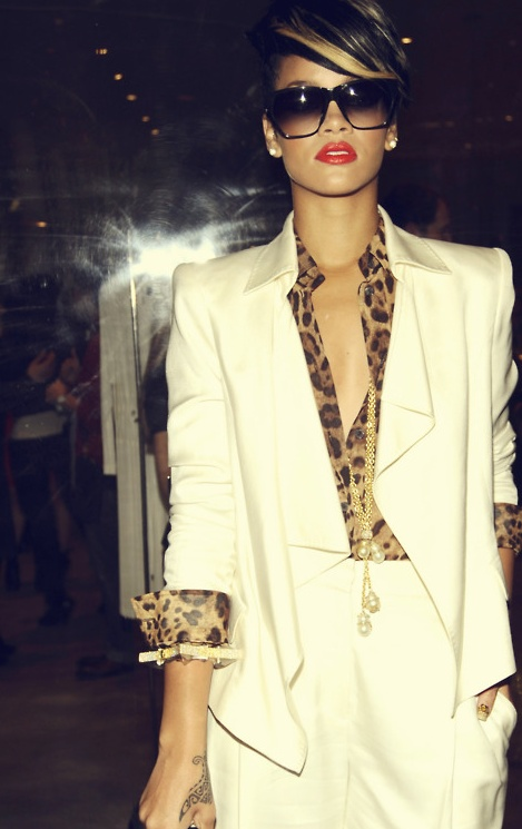 Rihanna, i hate to admit this, but you're a boss in that outfit. Cream suit and leopard blouse.