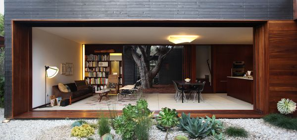 Michael Sylvester's Home, Venice, California. The living, dining and kitchen spaces open onto courtyards on both sides.  Photo by: Michael Sylvester