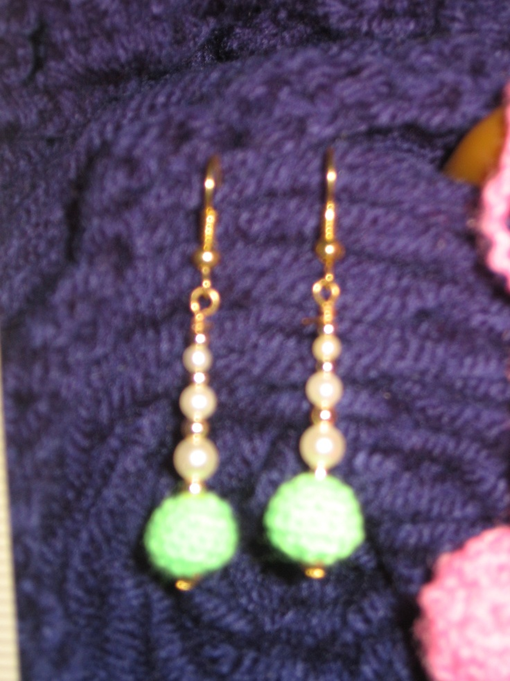 A pair of earrings that I made for a friend.  I crocheted the green balls on the bottom.