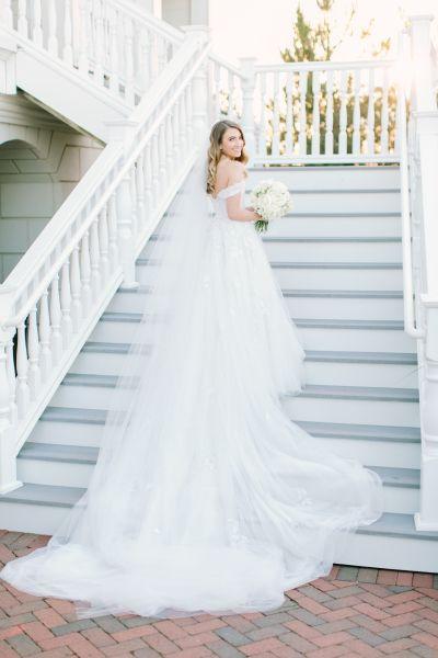 Elegant Mark Zunino wedding dress: http://www.stylemepretty.com/2016/11/20/real-princess-style-brides/ Photography: Love & Light - http://loveandlightphotographs.com/