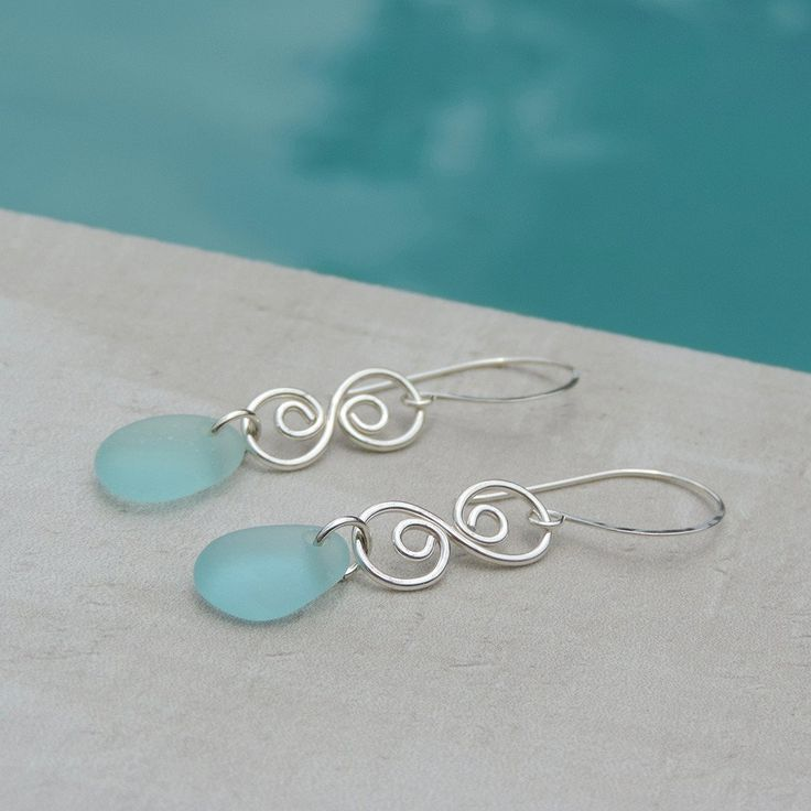 Enchanting Tides Earrings with Aquamarine sea glass that was found on a beach in California and worn smooth by the Pacific Ocean.