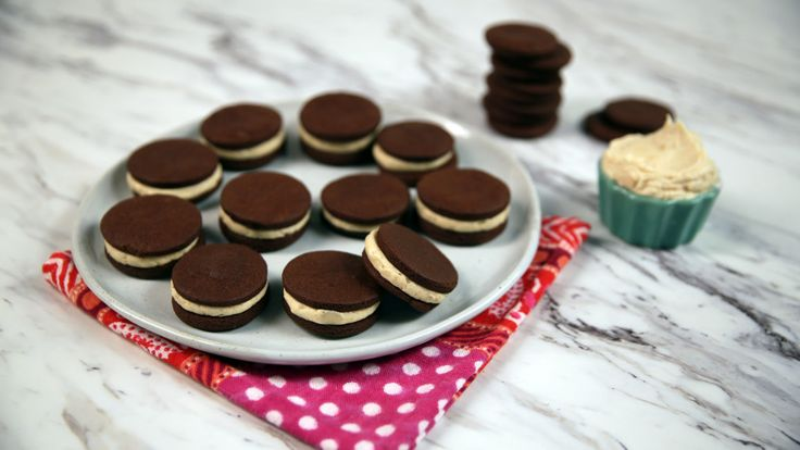 Recipe with video instructions: Homemade Oreos filled with peanut buttercream is a throwback to a certain 90s kid classic. Ingredients: Cookies:, 2 cups flour, 1 cup unsweetened cocoa powder, plus more for dusting, ¾ tsp kosher salt, 1 ¼ cups unsalted butter, at room temperature, ¾ cup sugar, 1 tsp vanilla extract, Powdered sugar, for dusting, Filling:, ½ cup unsalted butter, at room temperature, ¼ cup unsweetened smooth peanut butter, 1 ½ cups powdered sugar, 1 tsp vanilla extract, A pinch…