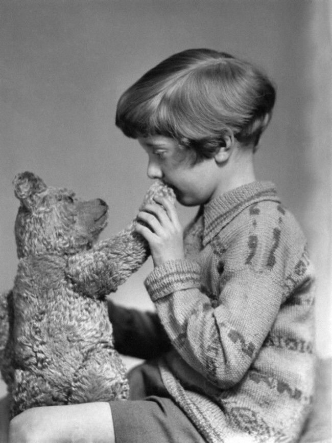 The real life Christopher Robin and Winnie the Pooh (1928). Christopher Robin Milne was the son of author A.A. Milne who based the Winnie the Pooh book series on Christopher's stuffed bear.