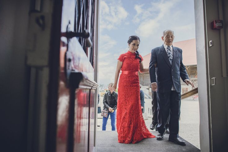 The grandfather escorting the beautiful bride for the tea ceremony. Photo by Monica Tarocco