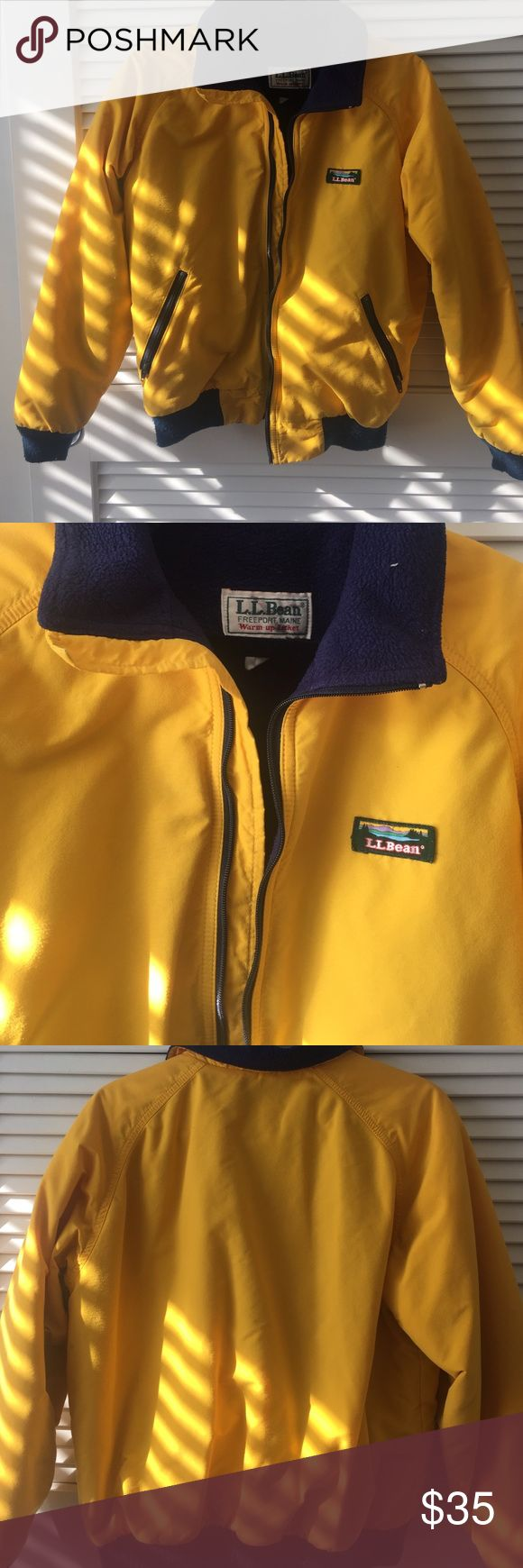LL Bean Women's warm up bomber jacket LL Beans women's warm up bomber jacket, has warm fleece material inside. Has two pockets that zip up, navy blue and yellow colored. L.L. Bean Jackets & Coats Puffers