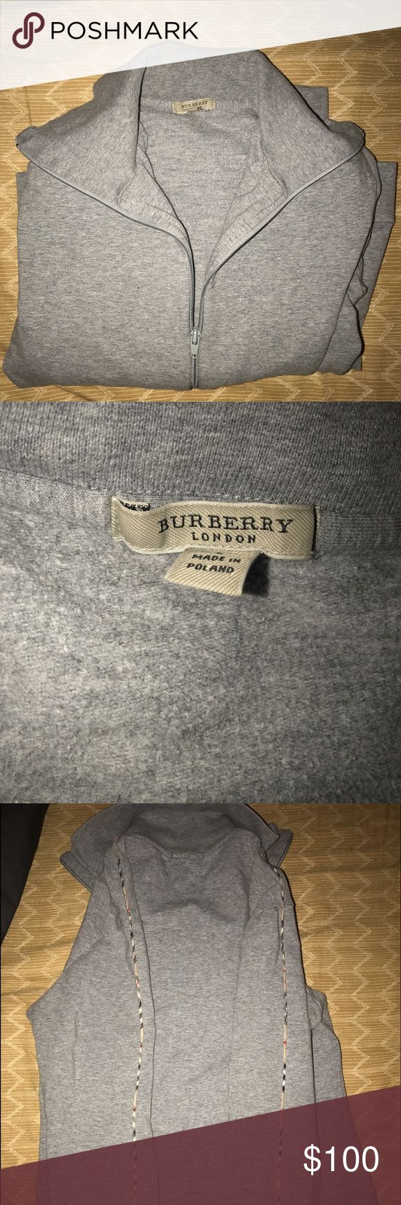 Burberry Zip Up Great Burberry lightweight jacket! Good for any occasion! 100 percent authentic, wife has had over a year and after pregnancy couldn't fit! Has a Burberry theme stripe coming through the entire back side of jacket! Size is large but does fit smaller. Will negotiate! Great gift for the holidays! Burberry Tops Sweatshirts & Hoodies