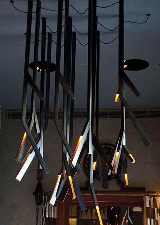 Lighting concept for Al Dente Restaurant twig like metallic fixtures
