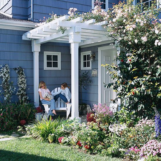 Highlight an Entry- mmmmmm pergola overhung with flowering vine and the  Adirondack chair, so - 17 Best Ideas About Front Porch Pergola On Pinterest Front Patio