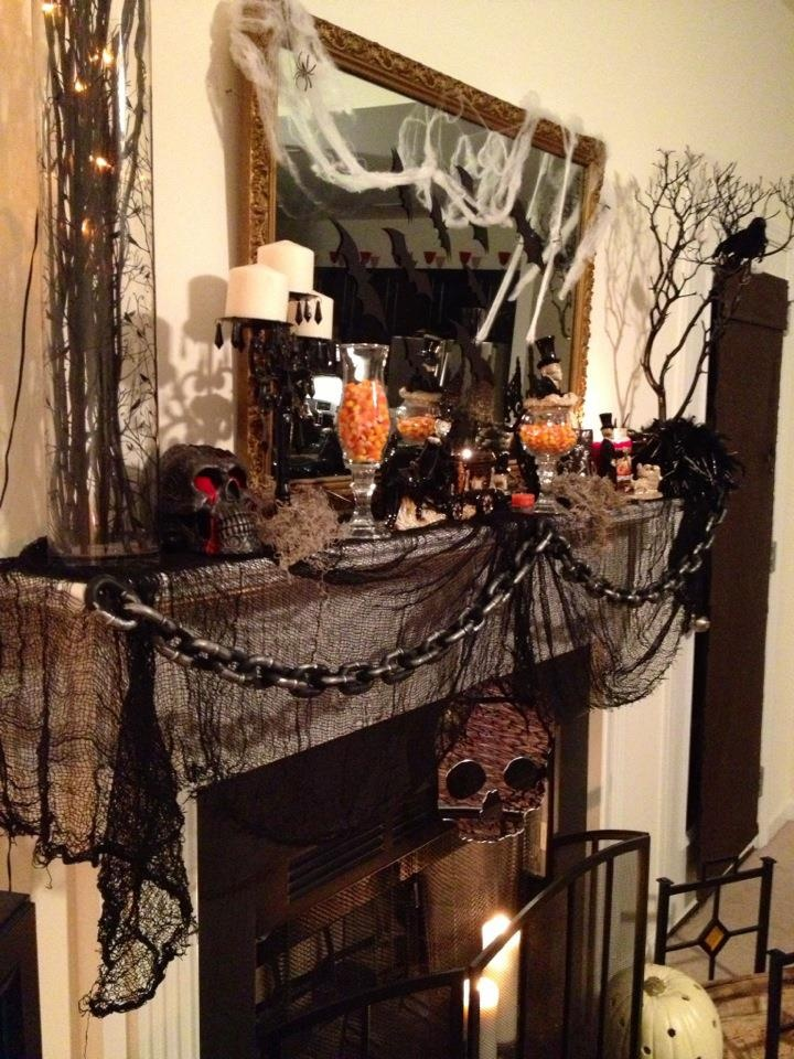 black cheesecloth and the chain set the mood for this decor - 2016 Halloween Decor