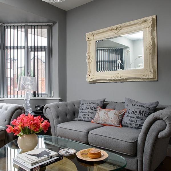 wonderful grey sofa and grand mirror