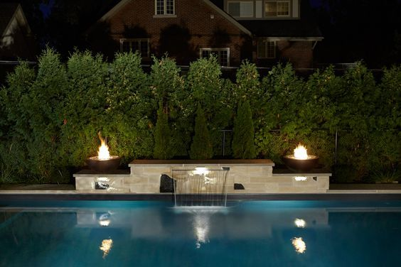 The Maddens elegant rectangle pool is the perfect blend of simplicity and modern design. The sheer descent waterfall completes the look.