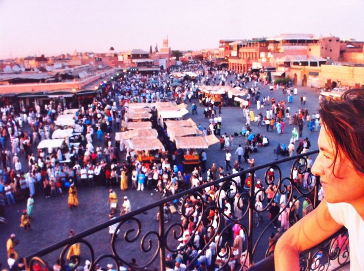 Place Jamaa el-Fna, Marrakesh. During the day is occupied by orange juice stalls, water sellers, youths with chained Barbary apes, and snake charmers. At night, the square fills with food-stalls. Awesome!!! A good place to contemplate everything that is Le Grand Balcon du Café Glacier