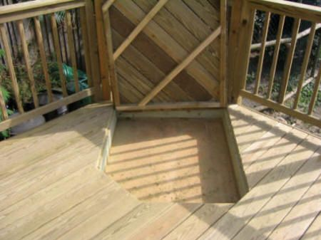 If you are wondering about including a sandpit area into your deck, this is one way it can be done.