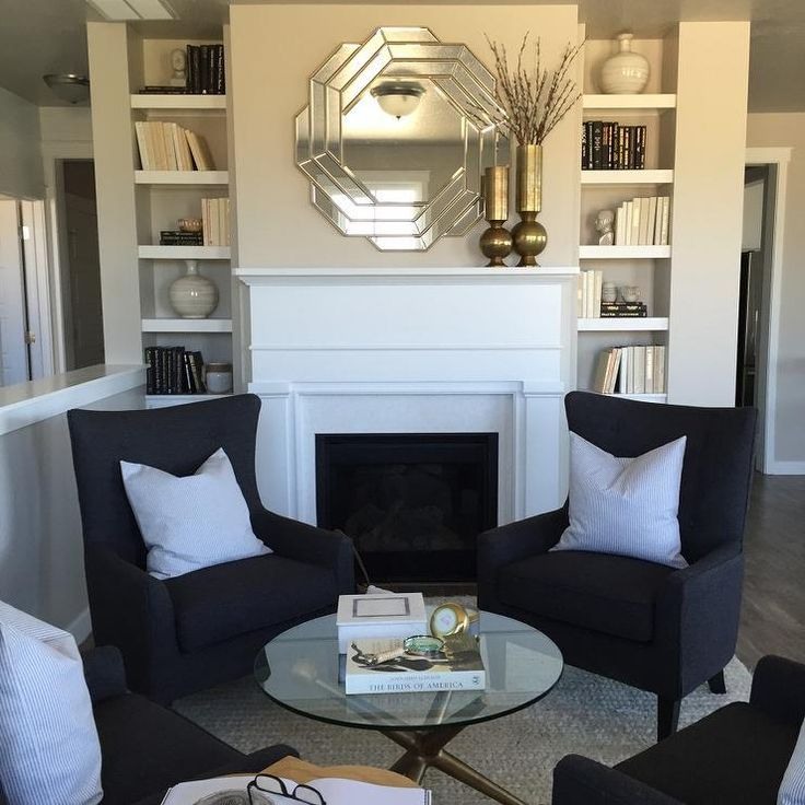 Chic sitting room features a white fireplace mantle and a for White mirrors for living room