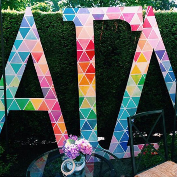Should Make our Letters Like these but each letter in tones of our colors red, buff, green