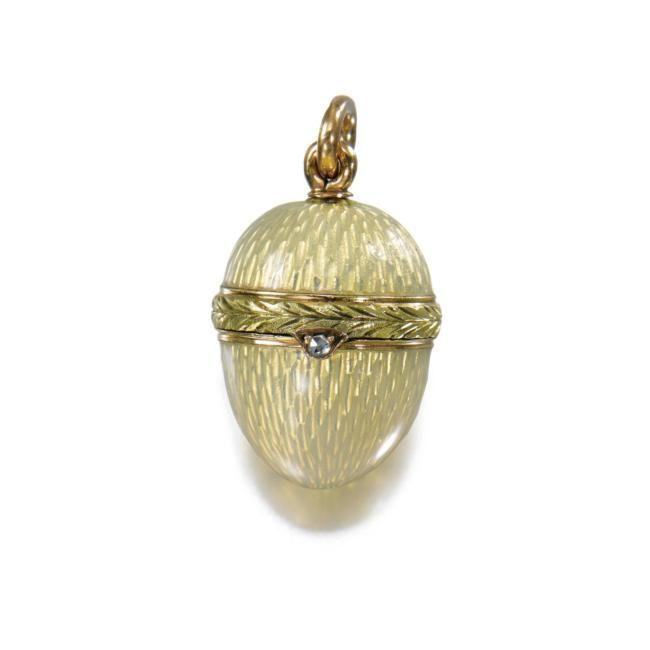 A Fabergé two-colour gold and enamel miniature egg pendant, workmaster: Michael Perchin, St. Petersburg, 1899-1903