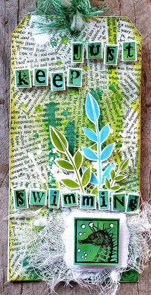 Tag by Belinda Spencer using Darkroom Door Torn Text Background Stamp, Carved Leaves, Seaside Inchies and Alphabet Medley Rubber Stamps. http://www.darkroomdoor.com/background-stamps/background-stamp-torn-text