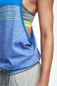 Balanced and breezy. The Nike Dri-FIT Knit Loose Tank is made with the perfect blend of materials to keep you dry and moving through every yoga pose. Shop @ FitnessApparelExpress.com