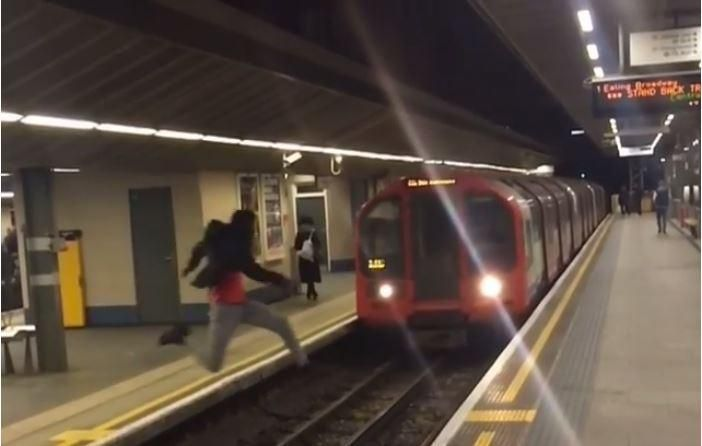 "Police have issued a stark warning after footage emerged of a ""reckless"" youth leaping in front of a moving Tube train at an east London station. British Transport Police said officers were investigating the shocking video which shows a man leap from one platform to another over tracks as a Central line service to Ealing Broadway pulls into Stratford station. A BTP spokesman told the Standard: ""Everyday our officers face tragedy on the railway, it is impossible to understand why this man put…"