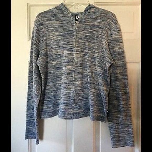 Free People metallic hoodie Super cute blue hooded jacket with silver sparkle! Cotton/lurex. Underarm across 17 inches. Length 20 inches. Excellent condition. Bundle for even bigger savings! Offers welcome. No trades. Free People Tops Sweatshirts & Hoodies