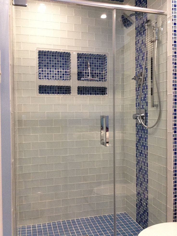 the mixed blue tile patterns with the striking stripe induce balance if you have questions about shower enclosures or