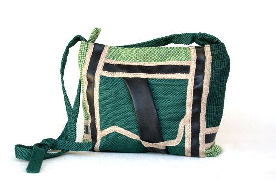 Shoulder bag with adjustable strap with knot, handmade with green furniture fabric, decorated with recycled bike tubes and beige cotton ribbon.