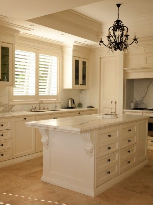 This Classic French Kitchen With A Subtle Antique Finish And Travertine Floor Exudes Elegance And Charm