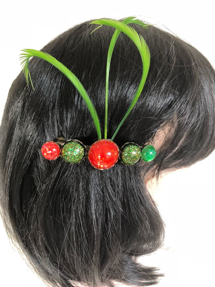 Excited to share the latest addition to my #etsy shop: French barette hair pin bobble in orange and green with three green feathers