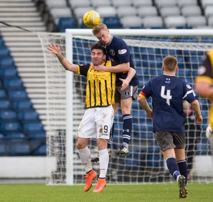 Queen's Park's Ross Millen wins the header during the Ladbrokes League One game between Queen's Park and East Fife.