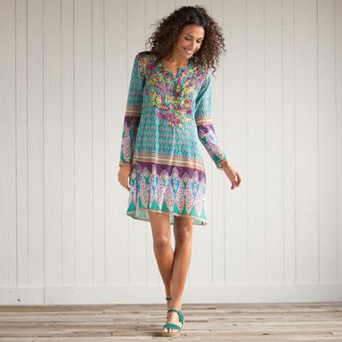 "GRAND BAZAAR TUNIC -- You'll wear our brilliant, easy-going tunic from winter's getaway all through summer, over leggings, jeans, shorts and swimsuits. Bordered with bright paisley at sleeves and hem, the Indian block print is lavished with embroidery on front and back. Notched neckline, side vents. Machine wash. Imported. Exclusive. Cotton. Sizes S (4 to 6), M (8 to 10), L (12 to 14), XL (16). Approx. 35""L."
