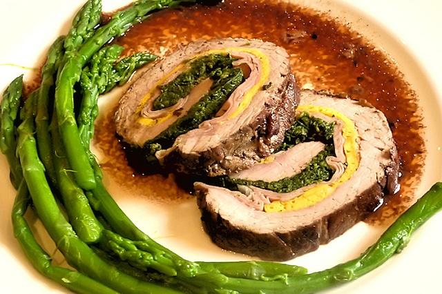 Rotolo alla Bolognese pot roast: veal, fritatta, Mortadella, cooked spinach