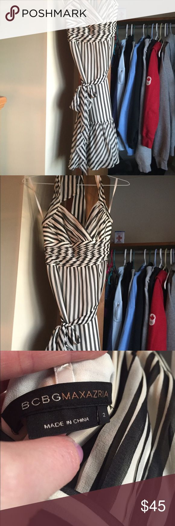 Bcbg cocktail dress Blk and white stripe cocktail dress - halter - ruffle on the bottom- wrap around waist tie. Looks great with a bow or knot. BCBG Dresses Midi
