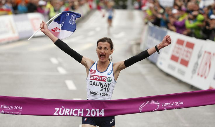 August 16, 2014  Christelle Daunay of France reacts as she crosses the finish line to win the women's marathon during the European Athletics Championships in Zurich, August 16, 2014. (REUTERS/Phil Noble)