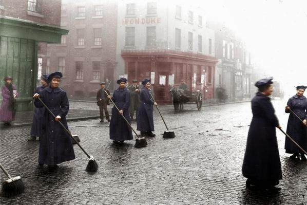 Female road sweepers cleaning the streets of Liverpool as the men are away fighting. 21st March 1916.
