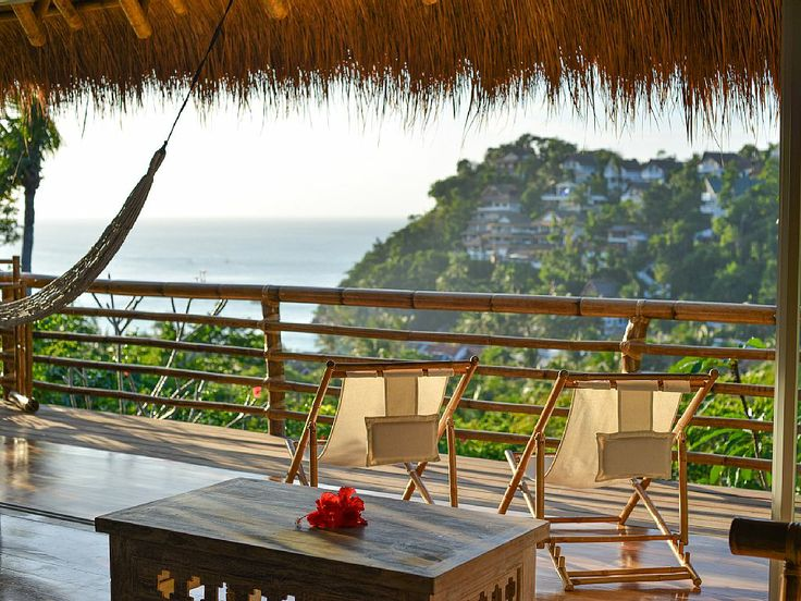 Sip a cocktail on the deck of your Borocay, Philippines villa while the sunsets.