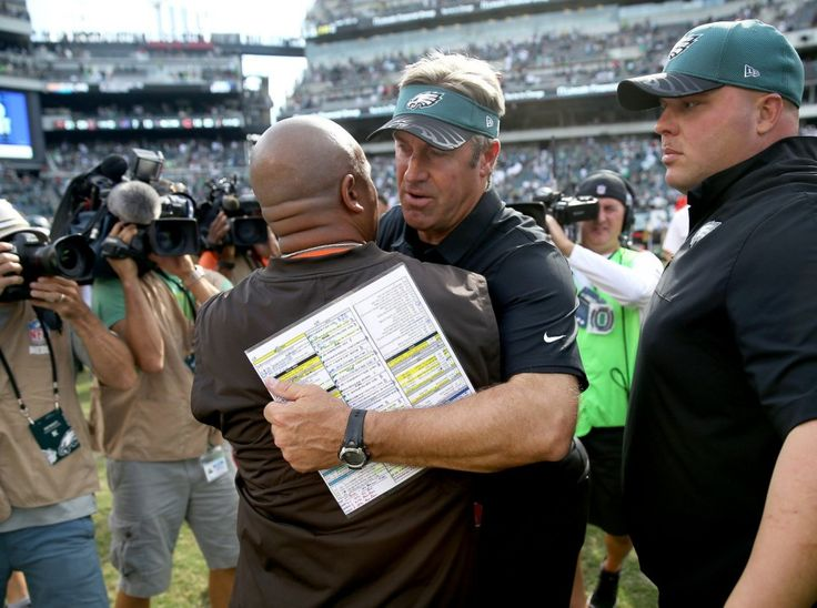 Eagles head coach Doug Pederson hugs Browns head coach Hue Jackson following the Eagles' 29-10 win at Lincoln Financial Field in Philadelphia, Sunday, Sept. 11, 2016. (Lori M. Nichols | For NJ.com)