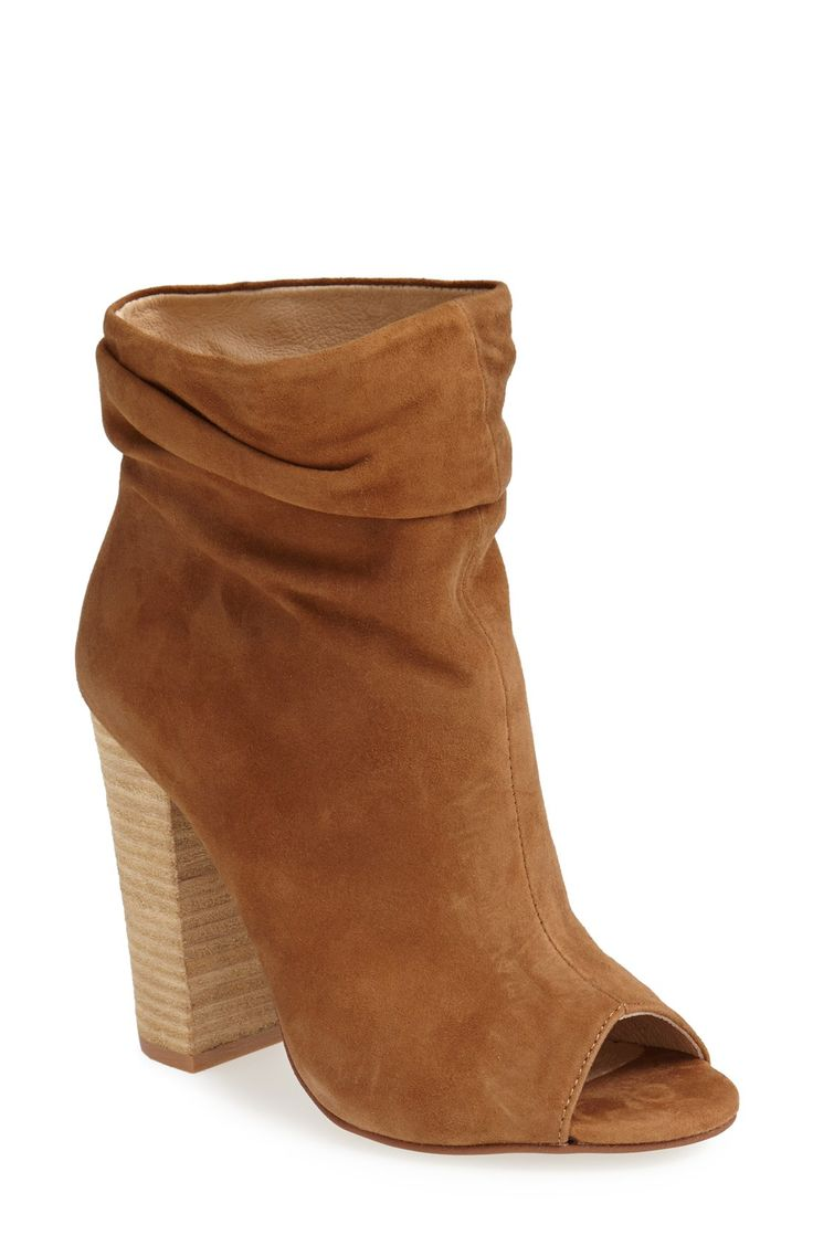 Love the stylishly slouchy look of these flirty peep toe booties.