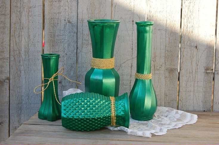 4 sparkly hand painted vases done in green and wrapped with gold trim, with a protective coating. They are not painted on the inside and can hold water for fresh flowers. Clean with a damp cloth, not