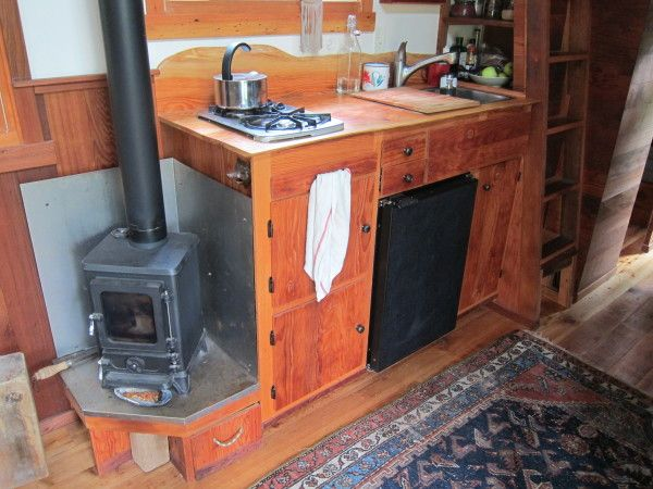 Tiny house wood stove in Colin's Coastal Cabin. His woodstove is