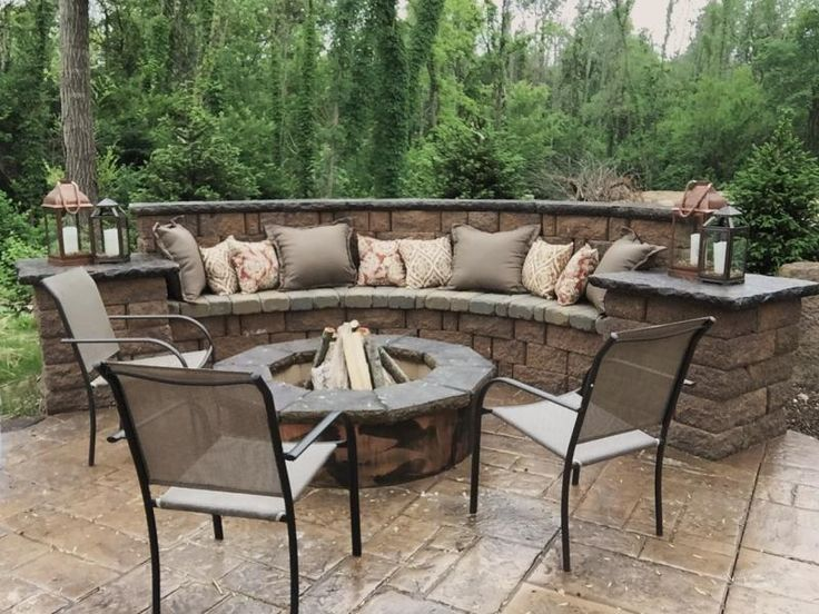 Backyard Concrete Patio Ideas stamped concrete patio medium grey color with black release Seating Wall Fire Pit And Stamped Concrete Patio