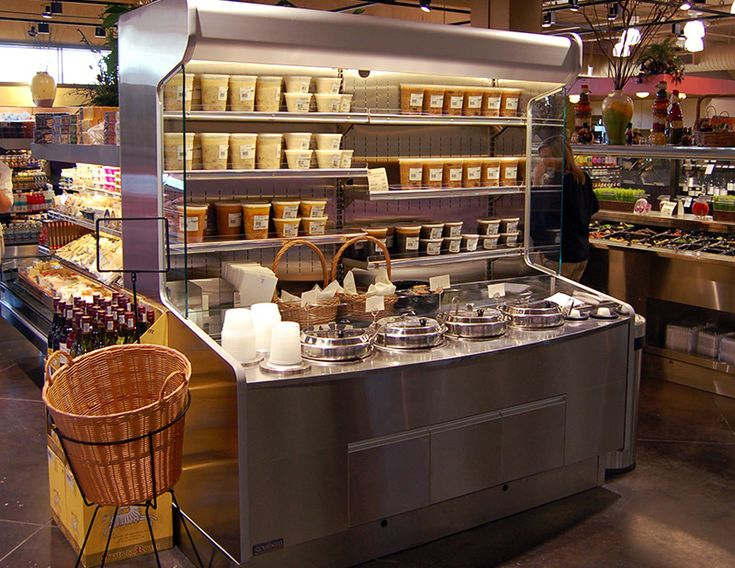 SST - Soup Station Merchandiser:  The SST is a soup station merchandiser specifically designed to support your store's soup program through customization, presentation, and functionality. Options include thermostatically controlled soup warmers (4, 7, or 11qt.), the addition of refrigerated display, and the inclusion of smallware storage and dispensers. The SST is a blank slate, ready for your inspiration. See below a small example of SST projects in the field.
