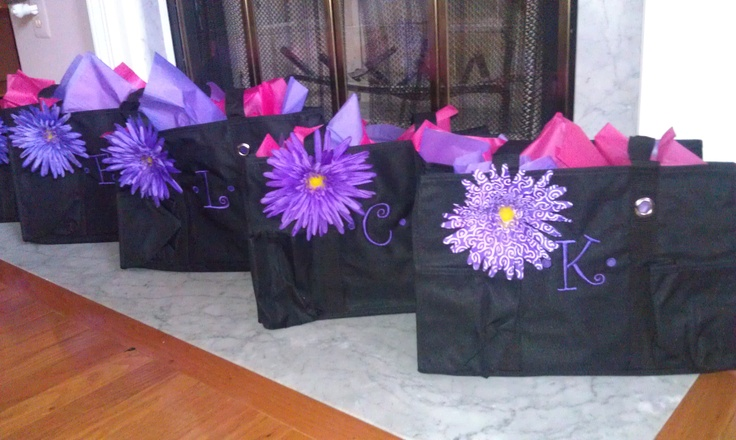 Bridal Party Gifts! Thirty One tote bags monogrammed with bridesmaids' initial, clip on silk flower from Michaels, filled with jewelry for the wedding and a Vera Bradley coin purse and notepad.