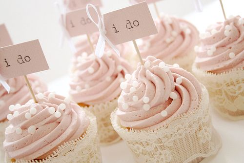 """Cute cupcakes. Instead of just """"I do"""", you could also have an """"I do too"""" sign. Or a """"we do""""."""