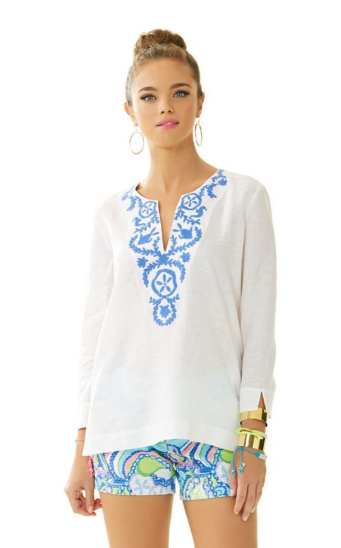 The Amelia Island Tunic is a linen tunic with embroidery at the neckline. Wear this with your favorite shorts or white denim. It's easy, chic, and perfect for any occasion.